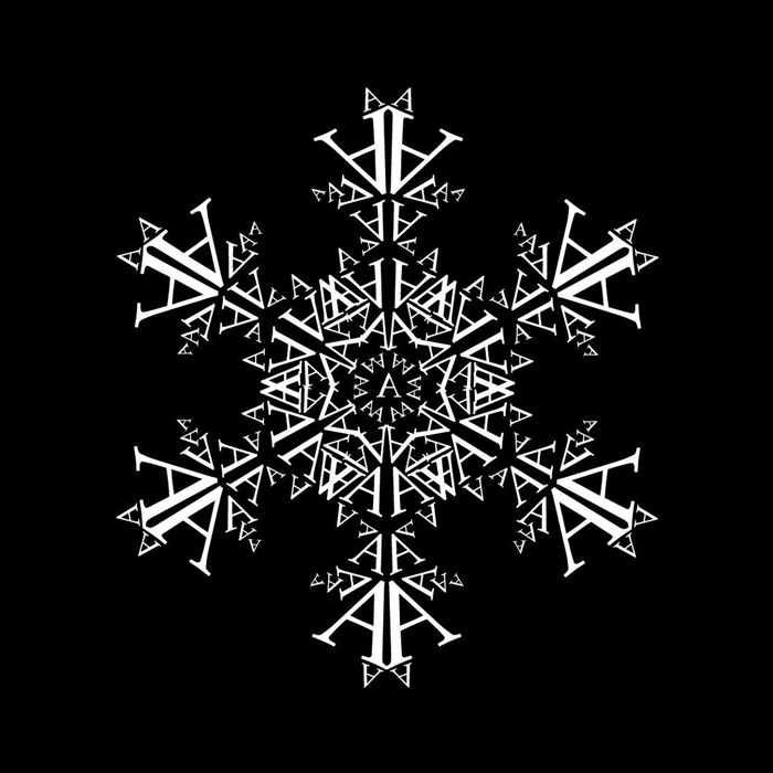 Sneen daler med versaler